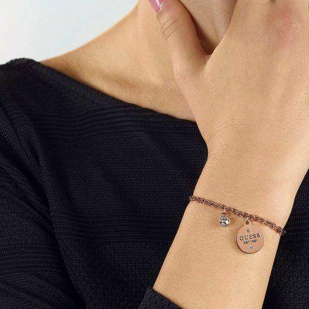 Biżuteria Guess damska bransoletka różowe złoto zawieszki UBB79055-L