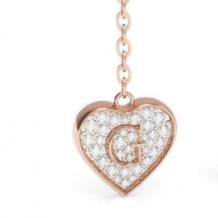 Biżuteria Guess kolczyki różowozłote wiszące serca Swarovski UBE79078